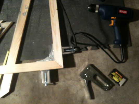 Next you need to secure the corners with wood glue and staples.