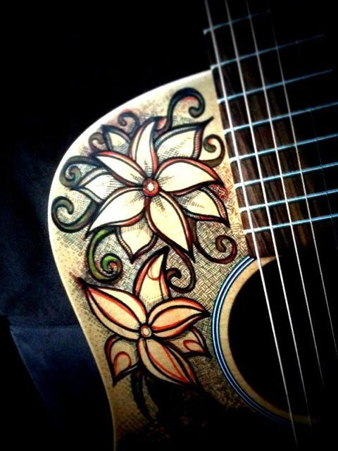 Flower drawing on Justin Michael's guitar (3/3)