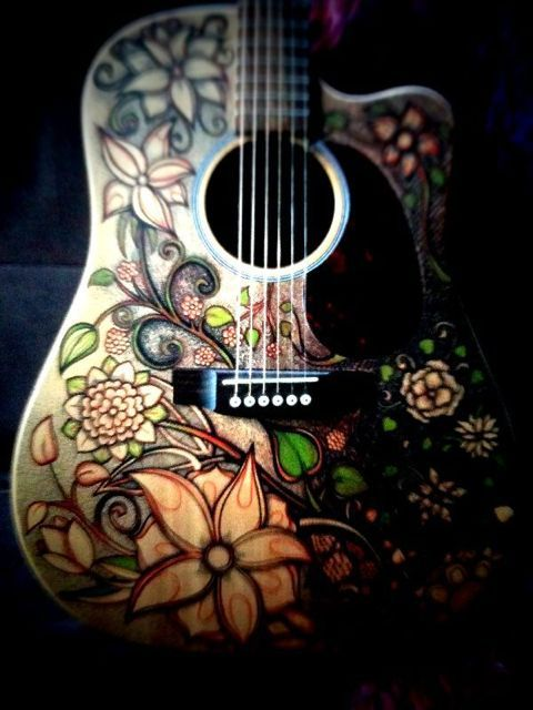 Flower drawing on Justin Michael's guitar (1/3)