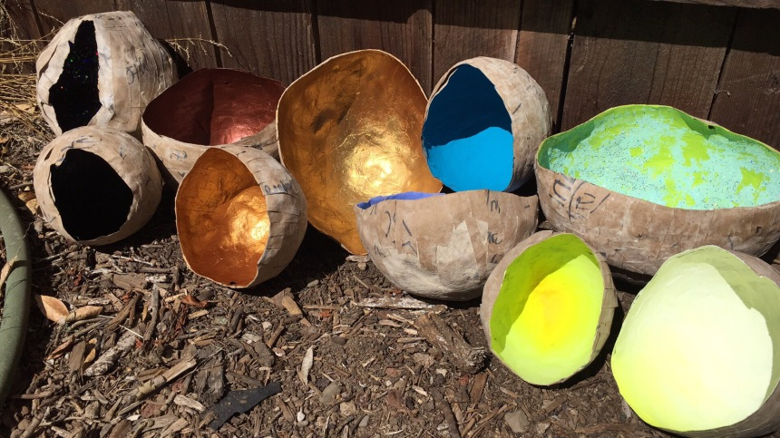rainbow paper bowls against the fence