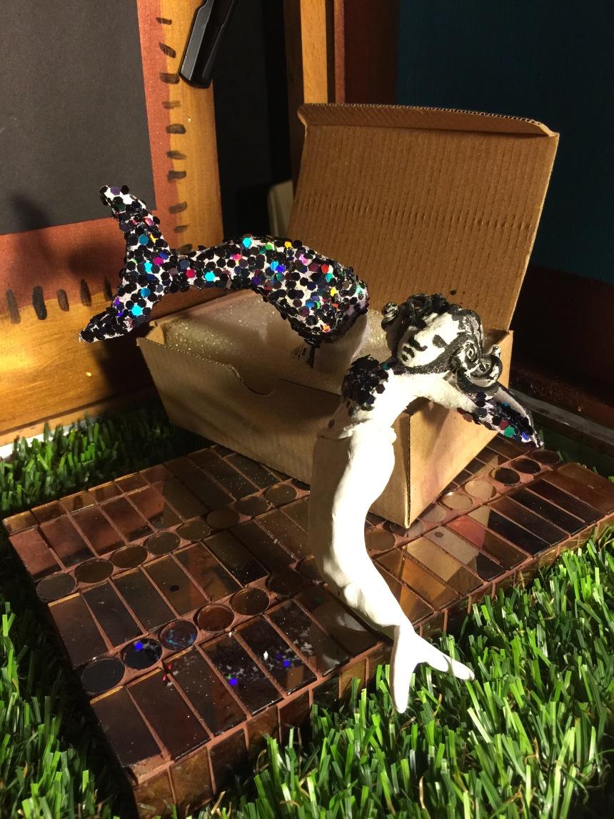 mermaid man jumping into box