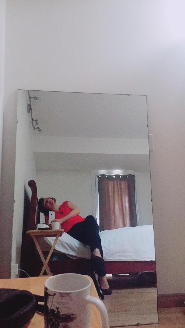 mitra in bed selfie