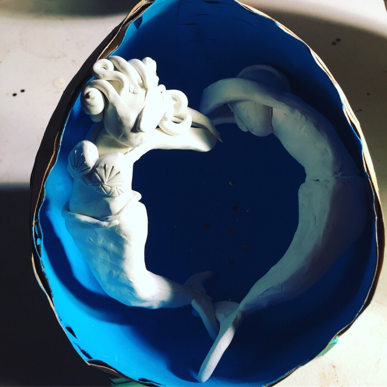 white mermaid couple in blue egg
