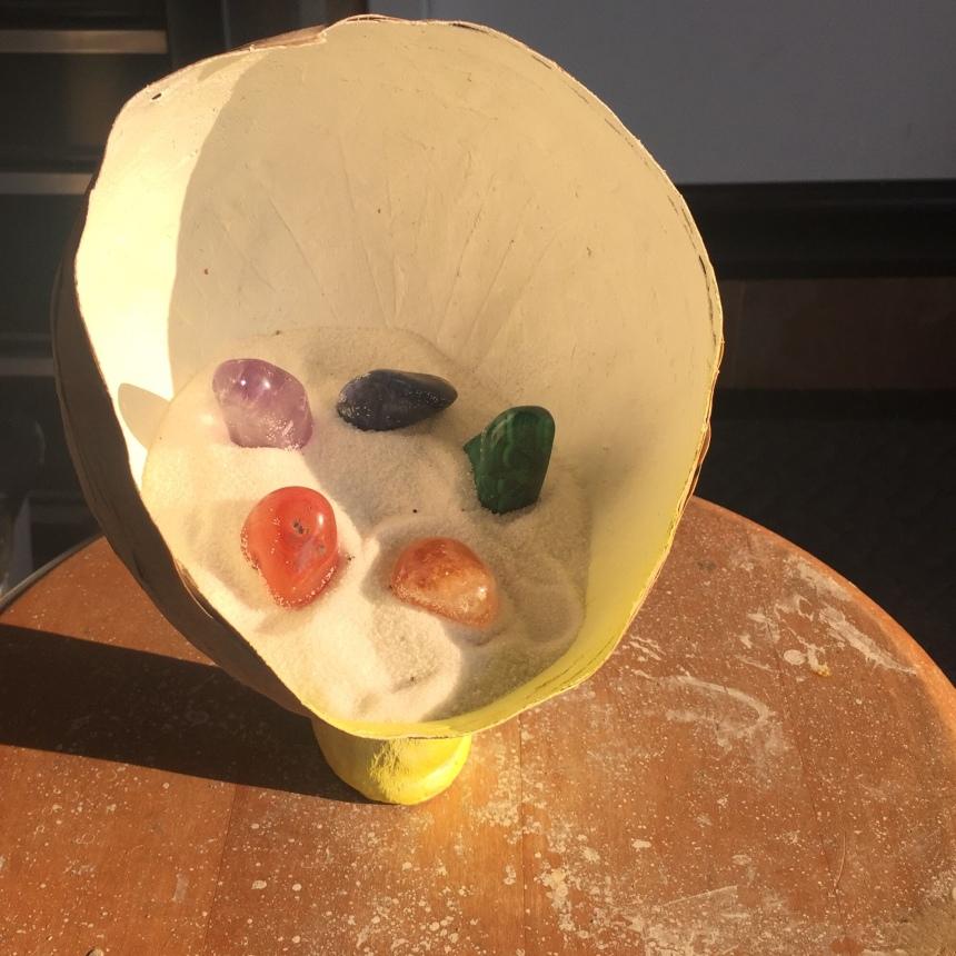 Papier-mâché rainbow stone circle