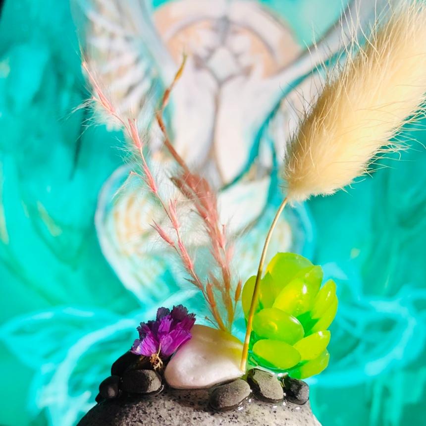 Mermaid Angles behind succulent garden sculpture