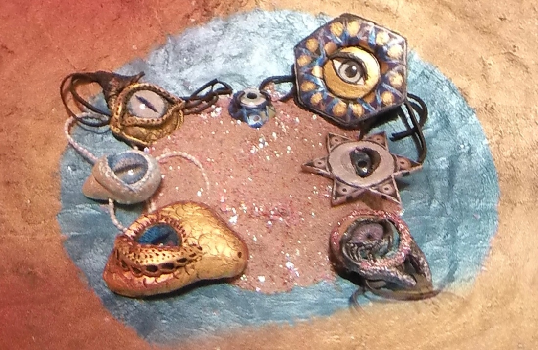 glass eye pendants in bowl together